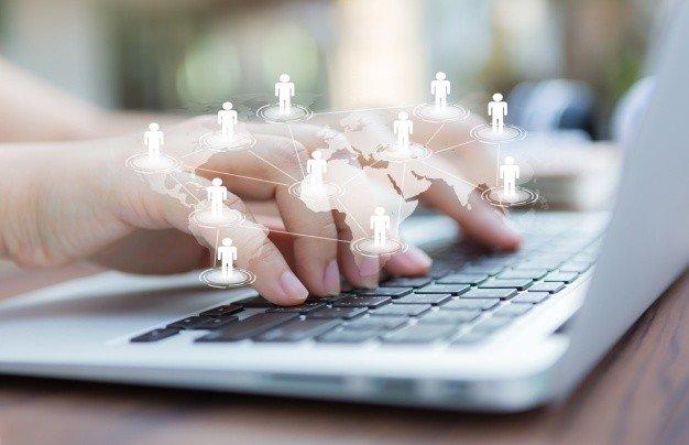 hands with laptop virtual world map 1232 876 - Создание сайтов в Усть-Каменогорске